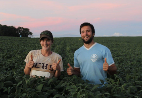 Figure 4: Caitlin Peterson and Pedro Nunes in the soybean crop at the Tupã experiment (summer cropping season 2016/17), after a successful day of sampling for Caity's PhD dissertation.